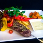 Grilled lamb kebab served with grilled capsicums and jalapeno chili with fries and garlic sauce